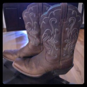 Brown cowboy boots with etched teal detail